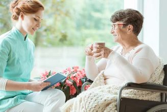 Caregiver with senior woman holding coffee
