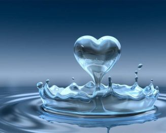 Water droplet bouncing up into a heart shape from lake surface