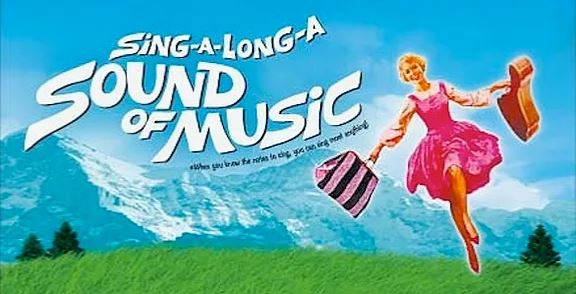 Advertisement for Sing-a-Long-a Sound of Music with graphic of Maria carrying guitar and bag in front of mountains with meadow and trees - When you know the notes to sing, you can sing most anything!