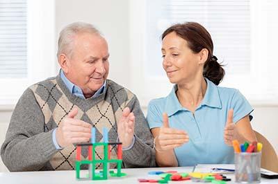 Alzheimer's/dementia caregiver works with senior man