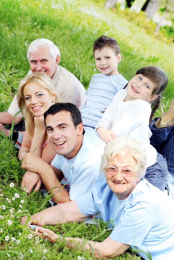 Multi-generational family outside on grass