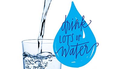 Drink lots of water - droplet with glass of water