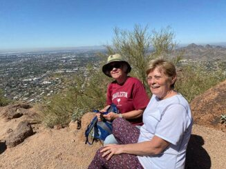 Sue Henderson with new friend hiking in AZ